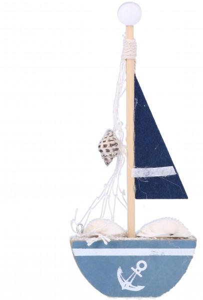 Barca a vela con conghiglie